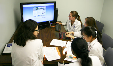 Medical students using a large screen monitor