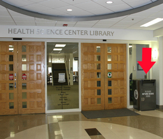 Bookdrop located on the 1st floor of the Communicore Building at the main entrance to the Library