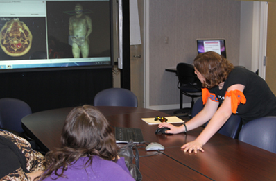 Students using the touch screen monitor in the Faculty Development Center (C2-41C)