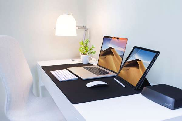 White computer desk with Apple products