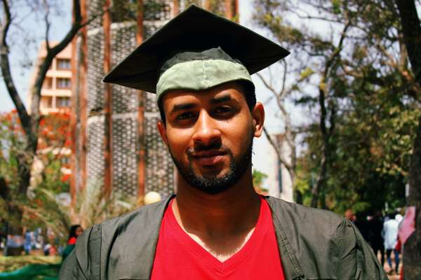 Graduate student looking at camera